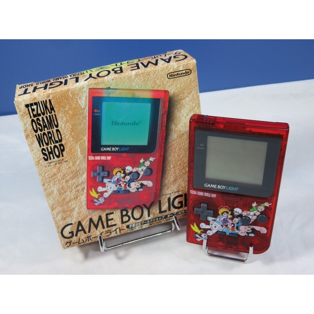 CONSOLE GAMEBOY LIGHT TEZUKA OSAMU WORLD SHOP CLEAR RED JPN OCCASION